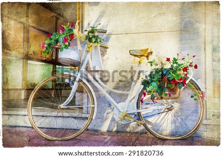 charming street  with bike and flowers, artistic vintage picture - stock photo