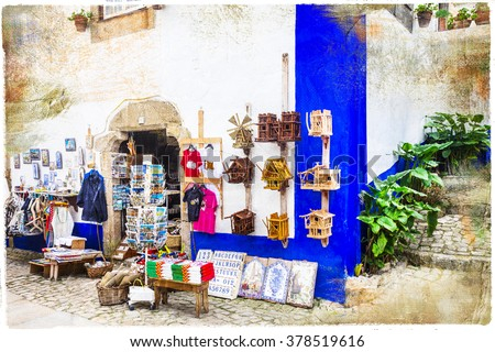 charming streets of old town Obidos in Portugal, artistic picture - stock photo