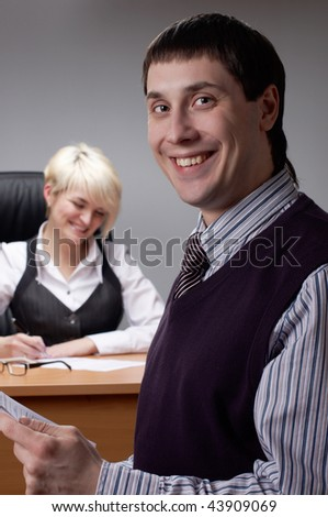 Charming the businessman with the colleague in office