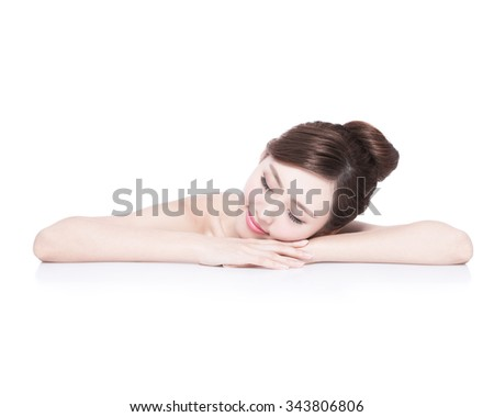 Charming woman face Smile enjoy spa and massage while lying isolated on white background, asian girl - stock photo