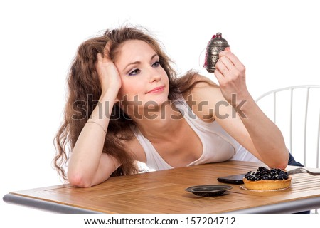 Charming woman in a restaurant, isolated