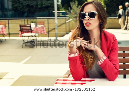 Charming woman in an outdoor restaurant
