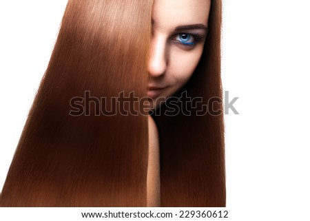 Charming woman with perfect straight long brown hair and blue eyes looking away in studio on white background. isolated - stock photo