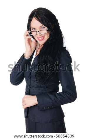 charming young business woman in a business suit calls on his cell phone