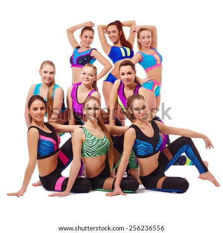 Charming young fitness girls posing at camera  - stock photo