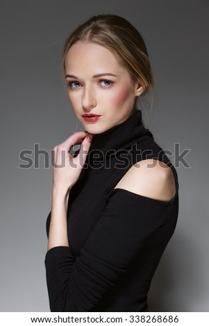 charming young lady touching her chin - stock photo