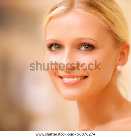 Charming young woman against beautiful grandiose hall. - stock photo