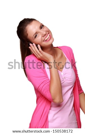 Charming young woman listens to music through headphones - stock photo