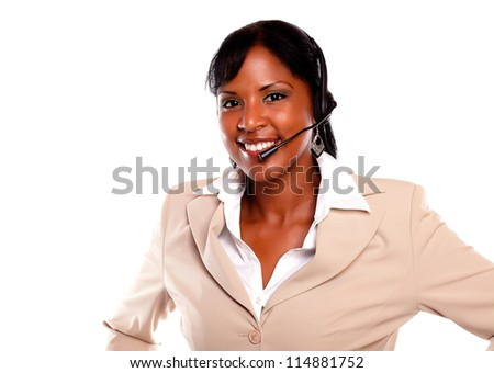 Charming young woman wearing a headset and smiling at you against white background - stock photo