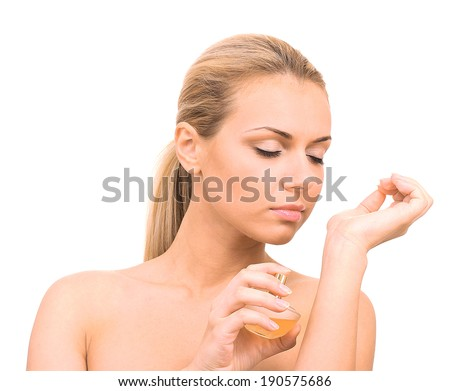 Charming young woman with perfume on white background close-up - stock photo