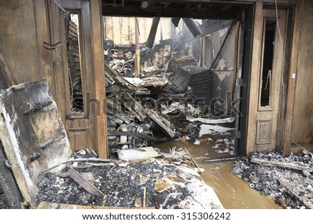 Charred out remains of a business, fire - stock photo
