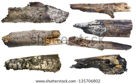 Charred smoking logs and pieces of wood from the Halloween fire set. Isolated. - stock photo