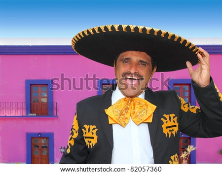 Charro mariachi man portrait shouting in mexican pink house [Photo Illustration] - stock photo