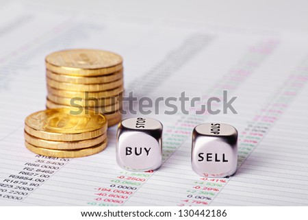 Chart, coins and dices cubes with words Sell Buy. Selective focus - stock photo