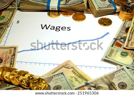 chart graph of wages rising up with gold and money - stock photo