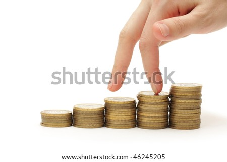 Chart made of columns of coins isolated on white background - stock photo