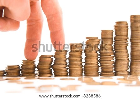 chart made of columns of coins isolated over white background - stock photo