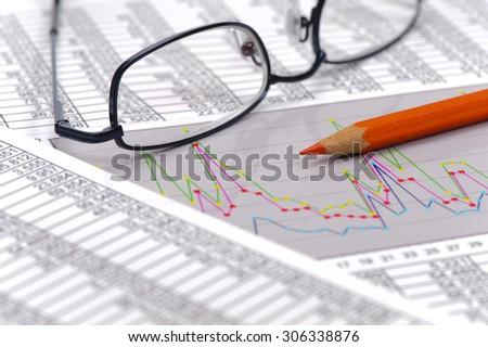 chart of stock exchange and spreadsheet - stock photo