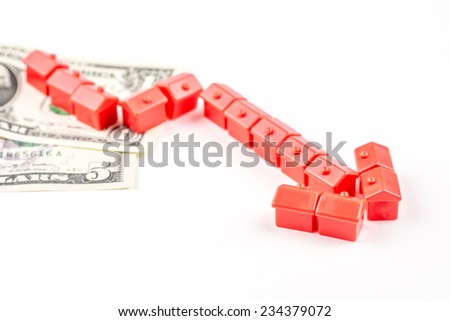 chart pattern made of miniature red houses is falling, business concept