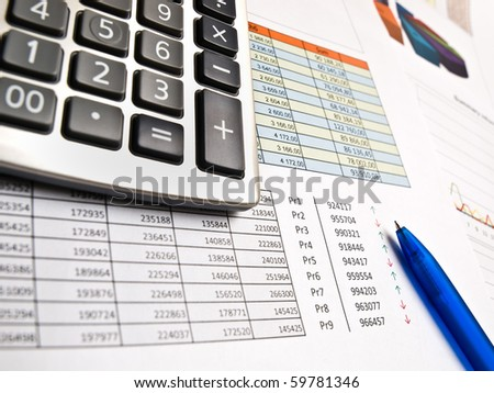 Chart with pen and calculator - stock photo