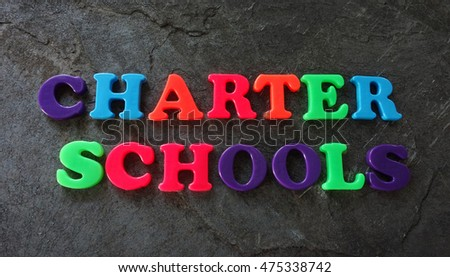 Charter Schools spelled out in colorful play letters -- education concept