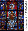 CHARTRES, FRANCE - APRIL 14: Blue Virgin with Child, a stained glass window in Chartres cathedral as seen on April 14, 2013 in Chartres, France. Chartres cathedral was built between 1194 and 1250. - stock photo