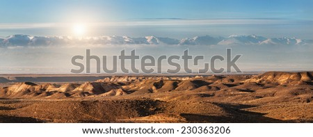 Charyn canyon and mountains in Kazakhstan - stock photo