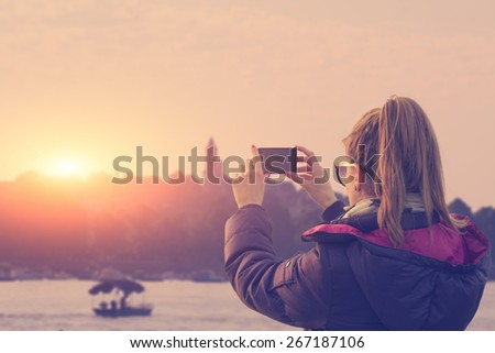 Chasing the sunset on a Danube river in Belgrade, Serbia, a view to old town of Zemun. - stock photo