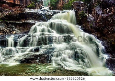 Chat Trakarn, paradise Waterfall located in deep forest of Thailand - stock photo