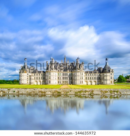 Chateau de Chambord, royal medieval french castle and reflection. Loire Valley, France, Europe. Unesco heritage site. Long exposure. - stock photo