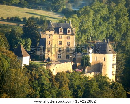 Chateau des Milandes in the Dordogne, France. As seen from a hot air balloon at sunrise. - stock photo