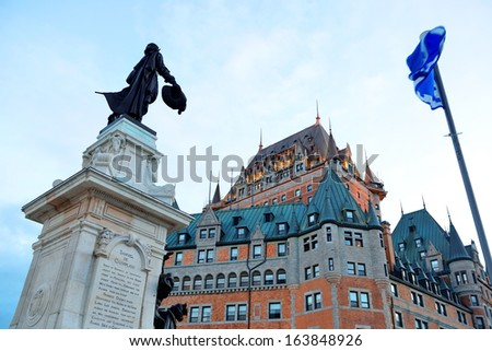 Chateau Frontenac with statue at dusk in Quebec City - stock photo