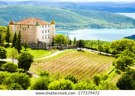 chateau in Aiguines and St Croix Lake at background, Var Department, Provence, France - stock photo