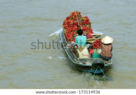 CHAU DOC, VIETNAM - DEC 29: Unidentified people are using a motorboat on Mekong river on Dec 29, 2013 on Chau Doc town, southern Vietnam. Motorboat is a common means of transport in Vietnam. - stock photo