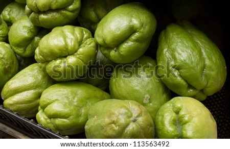 chayote also known as christophene or christophine, pear squash, vegetable pear,  chouchoute, choko is an edible fruit  belonging to the gourd family cucumbers and squash - stock photo