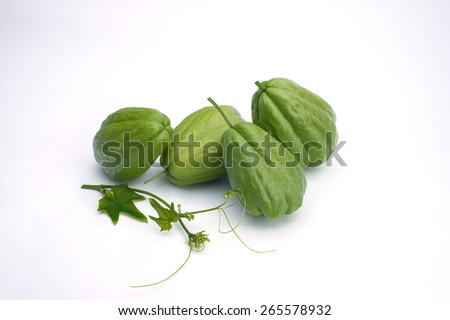 Chayote (cho-cho) fruit with young shoot isolated on plain background