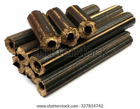 Cheap biofuel made of saw dust over white background - stock photo