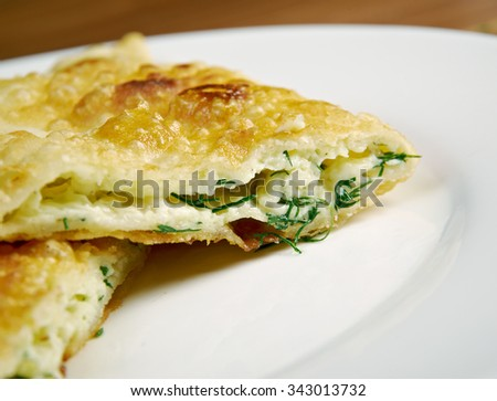 Cheburek  with cheese- traditional Caucasian dish.national dish of the Crimean Tatars and  Caucasian and Turkic peoples,  popular  Transcaucasia, Central Asia, Russia, Ukraine,  in Turkey and Romania.