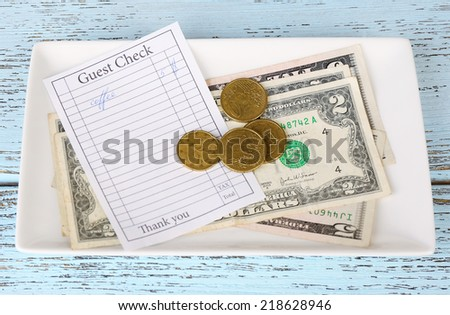 Check and money on table close-up - stock photo