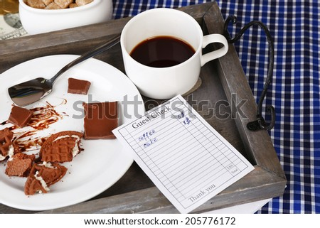 Check and remnants of food and drink on table close-up - stock photo