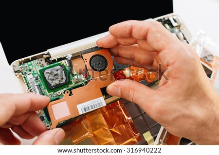 Check and warranty service of the laptop (pc, computer). Replacement of the broken parts - stock photo