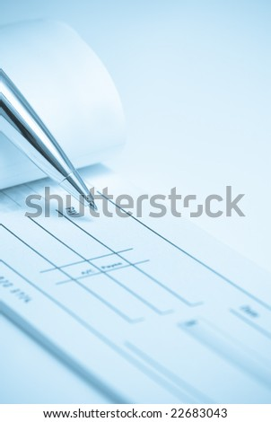 Check being written with blue cold tone - stock photo