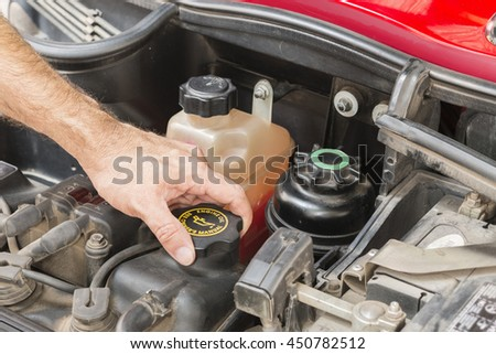 check engine oil car in shop - stock photo