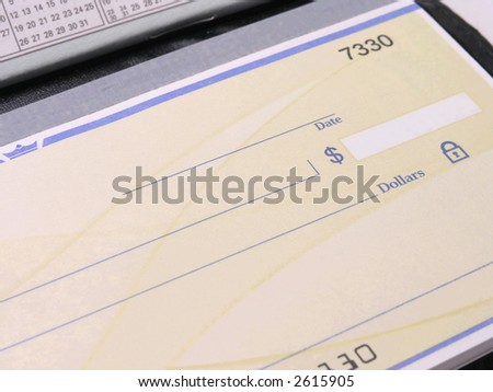 Check in open checkbook with calendar - stock photo