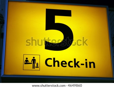 check in sign at airport with number five - stock photo
