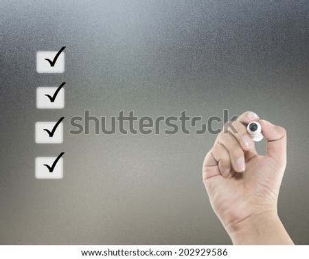 check list concept and hand with pen - stock photo