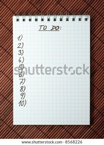 Check list on bamboo mat - stock photo