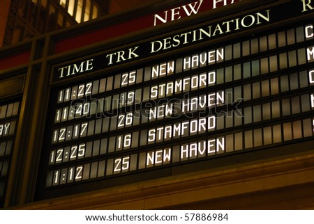 Check out the train schedule board - stock photo