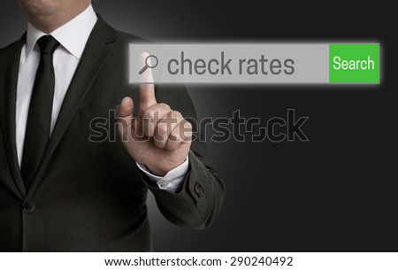 Check Rates internet browser is operated by businessman. - stock photo