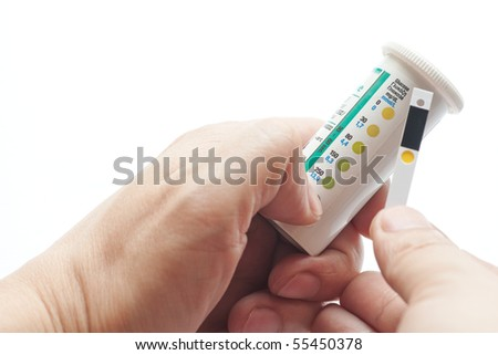 check the blood glucose test strips - stock photo
